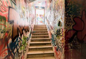 graffiti filled corridor, car for sale